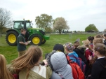 Driver driving a tractor with no hands and blindfolded around obstacles